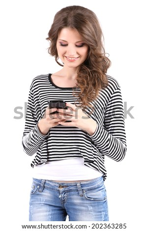 Beautiful young girl with mobile phone isolated on white - stock photo