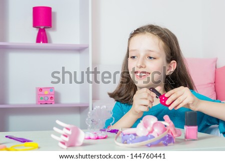 Beautiful young girl with nail polish - stock photo