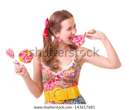 Beautiful young girl with pink spiral lollipops on white background. - stock photo