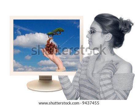 Beautiful young girl with plant isolated over a white background - stock photo