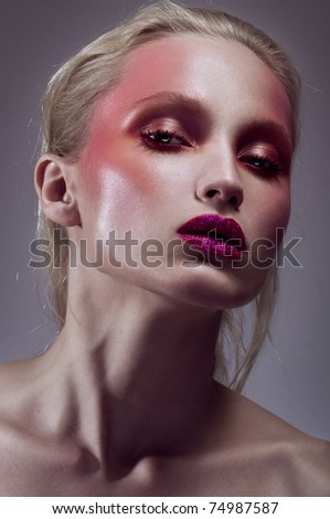 Beautiful young girl with purple lips - stock photo