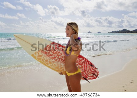 beautiful young girl with surfboard at kailua beach, hawaii - stock photo