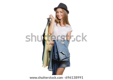Beautiful young girl with things jeans t-shirt and with a sale hat on white background isolation