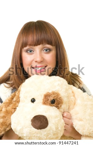 Beautiful young girl with toy dog isolated on a white background - stock photo