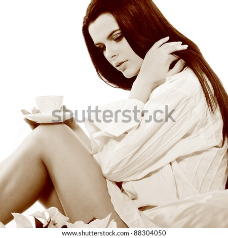 beautiful young girl with tulips and with the cup of coffee, isolated on a white background - stock photo