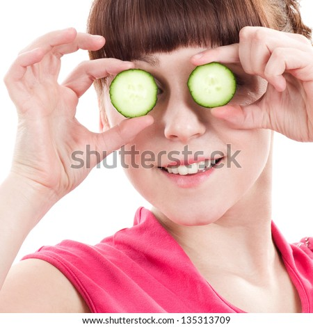 Beautiful young girl with vegetable on white background. - stock photo