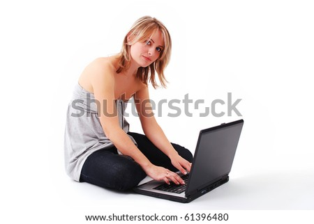 beautiful young girl working on laptop - stock photo