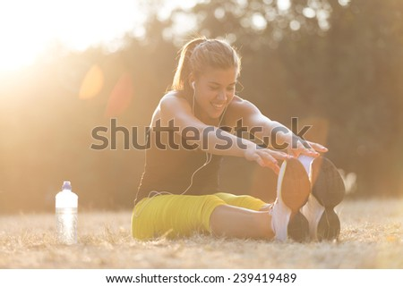 Beautiful young girl working out in the park