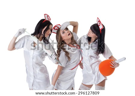 Beautiful young girls dressed as seductive nurses - stock photo