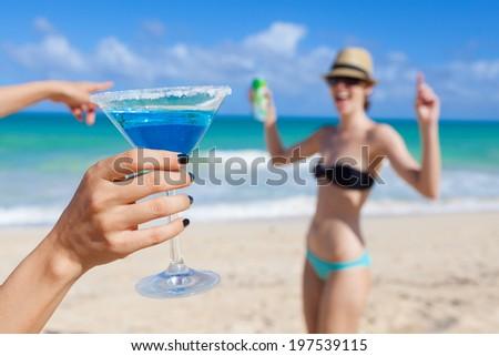 Beautiful young girls having fun at the beach in Hawaii. Beach party. - stock photo