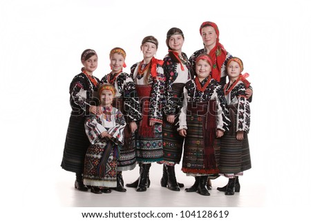 beautiful young girls in national costumes - stock photo