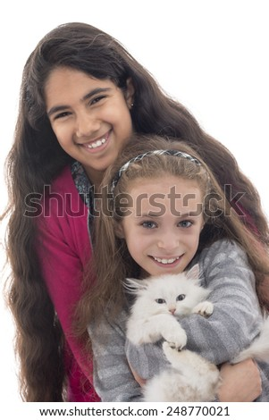 Beautiful Young Girls Playing with A Cat Isolated on White Background - stock photo