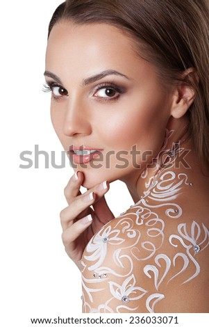 Beautiful young glamour woman with fantasy flower body art. soft perfect skin. smiling model face. - stock photo