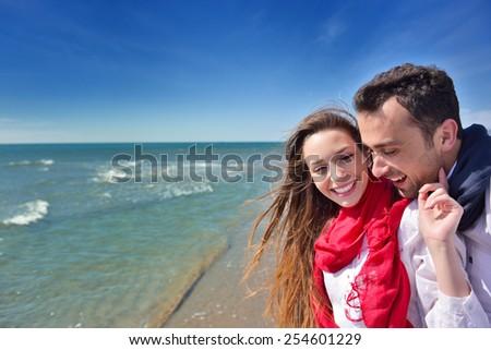 beautiful young happy couple enjoying at sea - stock photo