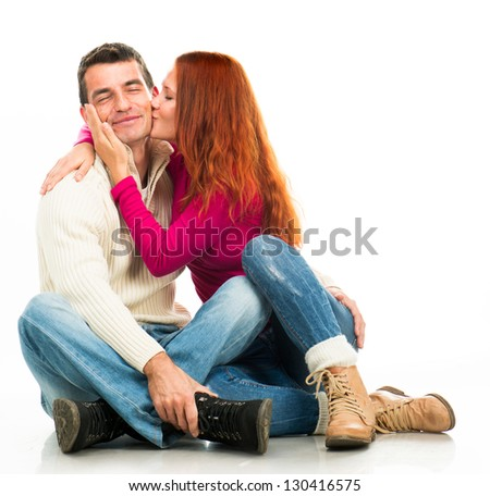 Beautiful Young happy couple kissing on white background - stock photo