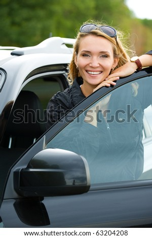 beautiful young happy woman in the new car  - outdoors - stock photo