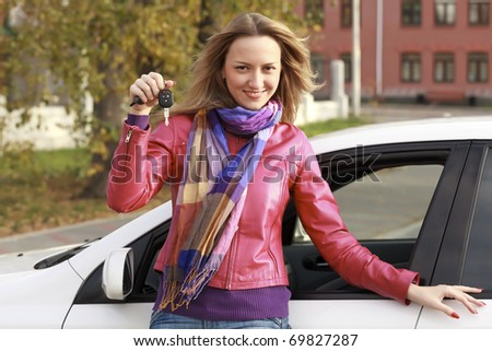 Beautiful young happy woman with car keys - stock photo