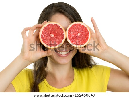 Beautiful young happy woman with fruit - stock photo