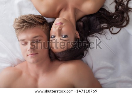 Beautiful young heterosexual couple in bed