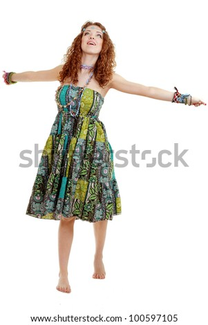 beautiful young hippie woman in hippie outfit with hippie art make up