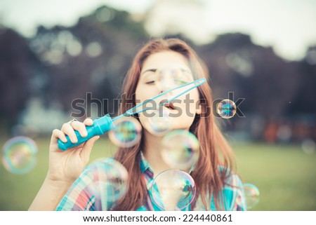 beautiful young hipster woman in the city - stock photo