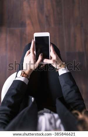 Beautiful young hipster woman using smartphone.  - stock photo