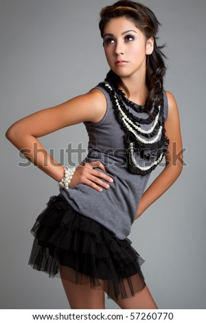 Beautiful young hispanic fashion girl - stock photo