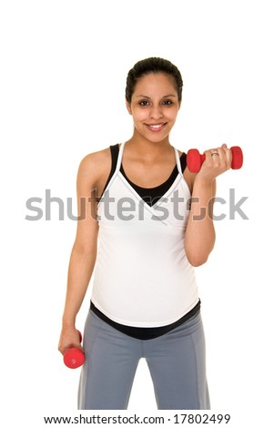 Beautiful young, Hispanic woman in a fitness workout using hand weights to keep herself physically fit during her pregnancy.  Shot on white background. - stock photo