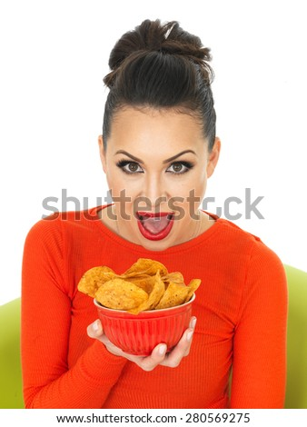 Beautiful Young Hispanic Woman With a Bowl of Hot Spicy Tortilla Chips Against A White Background