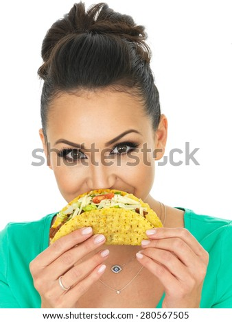 Beautiful Young Hispanic Woman With Crispy Chilli Beef Tacos with Salad and Grated Cheese Against A White Background