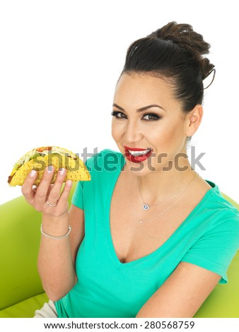 Beautiful Young Hispanic Woman With Crispy Chilli Beef Tacos with Salad and Grated Cheese Against A White Background - stock photo