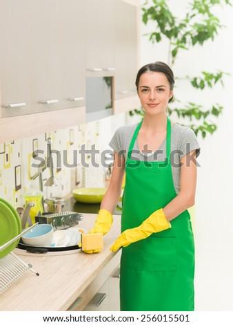 beautiful young housewife washing dishes - stock photo