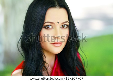 Beautiful young indian/asian woman portrait in traditional clothing. gorgeous brunette traditionally dressed Outdoors in India. - stock photo