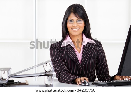 beautiful young indian businesswoman in office - stock photo