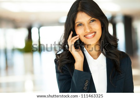beautiful young indian businesswoman talking on cell phone - stock photo