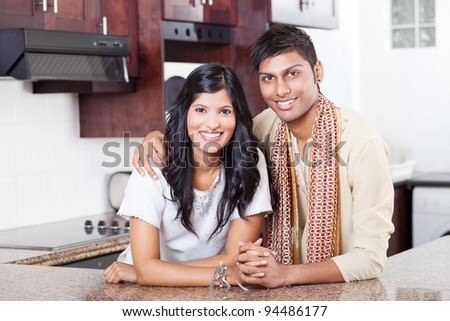 beautiful young indian couple portrait at home - stock photo