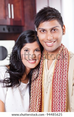 beautiful young indian couple portrait in traditional clothing - stock photo