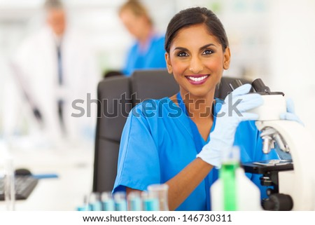 beautiful young indian lab technician working in the laboratory - stock photo