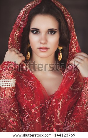 stock photo beautiful young indian woman bellydancer n traditional clothing with bridal makeup and jewelry 144123769