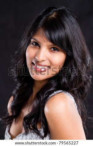 beautiful young indian woman portrait on black background - stock photo