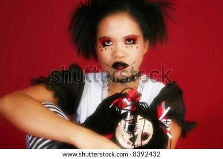 Beautiful young Indonesian woman dressed as anime goth doll. - stock photo