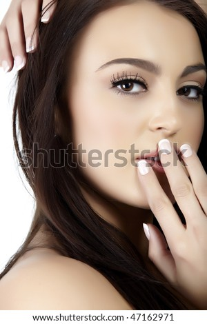 Beautiful young Italian woman with natural make-up and loose long hair - stock photo