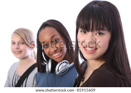 Beautiful young Japanese student girl with two other multi ethnic teenage friends, a mixed race african american and blonde caucasian girl, all with happy smiles.