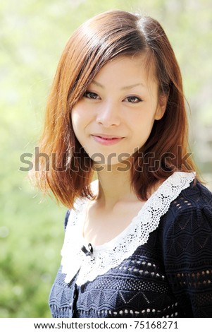 Beautiful young japanese woman on the green