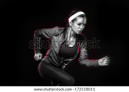 Beautiful young jogging woman. Isolated over black background (colored, retouched) - stock photo