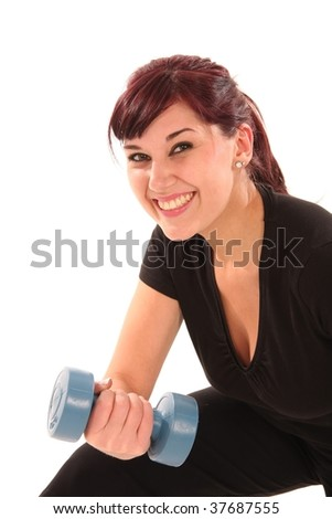 Beautiful young lady exercising with weights