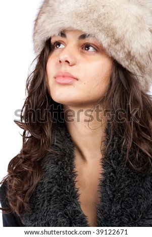 Beautiful young lady in winter coat and hat isolated on white background
