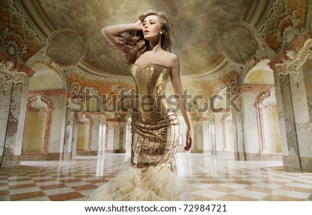 Beautiful young lady posing in a stylish interior - stock photo