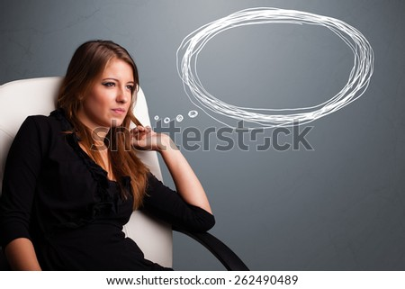 Beautiful young lady thinking about speech or thought bubble with copy space - stock photo
