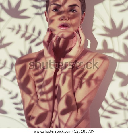 Beautiful young lady with a delicate floral pattern on body - stock photo